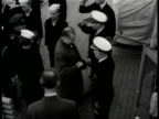 Turkish generals officials up steps to US ship HA MS Turkish officials being greeted by US captain on ship VS Turkish US officers on deck walking...