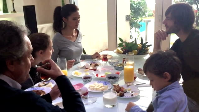Turkish happy family doing breakfast