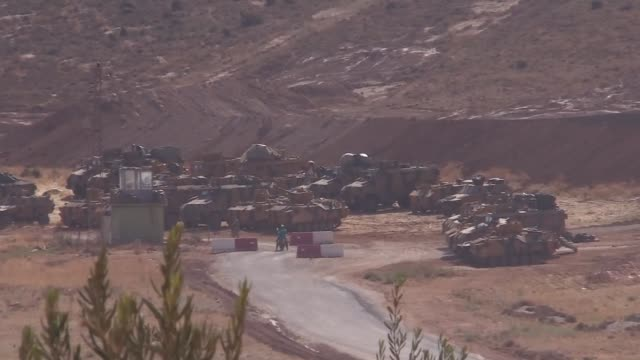Turkish military vehicles are deployed on the Syrian border in Reyhanli district of Hatay province southern Turkey on October 09 2017 Turkish...