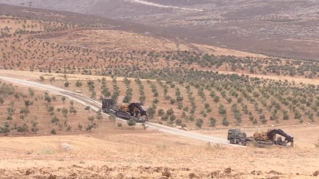 Turkish military vehicles are deployed on the Syrian border in Reyhanli district of Hatay province southern Turkey on October 9 2017 Turkish military...