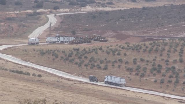 Turkish military vehicles are deployed on the Syrian border in Reyhanli district of Hatay province southern Turkey on October 10 2017 Turkish troops...