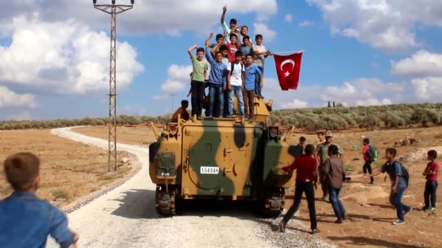 Turkish military vehicles are deployed on the Syrian border in Reyhanli district of Hatay province southern Turkey on October 11 2017 Turkish troops...