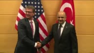 Turkish National Defense Minister Fikri Isik and United States Secretary of Defense Ashton Carter hold a meeting at NATO Headquarters in Brussels...