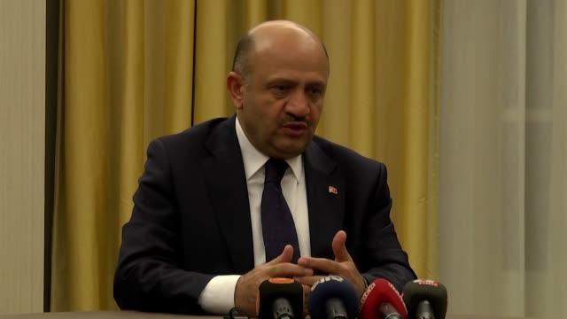 Turkish National Defense Minister Fikri Isik and US Secretary of Defense Ashton Carter attend an international antiDaesh meeting in London England on...