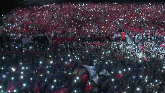 """Turkish people hold national flags as they wait for the Turkish President Erdogan to attend the rally of """"Millions as One Voice against Terror' in..."""