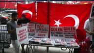 Turkish people who protest Fetullah Gulen in the wake of a recent coup attempt in Turkey distribute copies of a Turkish newspaper with a Gulen...