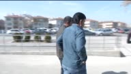 Turkish policemen escort two of the 14 Ankara terror attack suspects while leaving a hospital after physical examinations in Ankara Turkey on...
