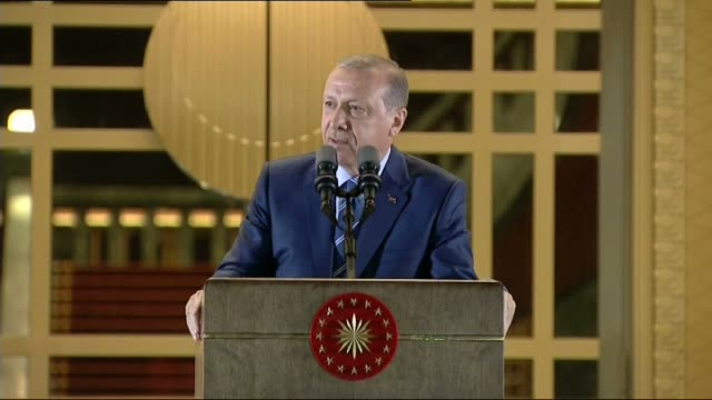 Turkish President Recep Tayyip Erdogan addresses the people gathering in front of the Presidential Complex to protest July 15 failed military coup...