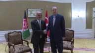 Turkish President Recep Tayyip Erdogan and Afghan President Ashraf Ghani hold a meeting on the sidelines of the Organisation of Islamic Cooperation's...