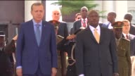 Turkish President Recep Tayyip Erdogan and his wife Emine Erdogan are welcomed by Ugandan President Yoweri Museveni and his wife Janet Museveni with...