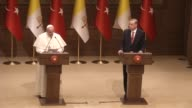 Turkish President Recep Tayyip Erdogan and Pope Francis hold a joint press conference following their meeting at Turkey's Presidential Palace on...