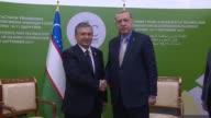 Turkish President Recep Tayyip Erdogan and Uzbek President Shavkat Mirziyoyev hold a meeting on the sidelines of the Organisation of Islamic...