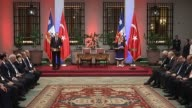 Turkish President Recep Tayyip Erdogan delivers a speech during a joint press conference with Chilean president Michelle Bachelet following a signing...