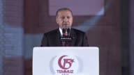 Turkish President Recep Tayyip Erdogan delivers a speech during a commemoration ceremony outside the parliament in Ankara on July 16 2017 as part of...