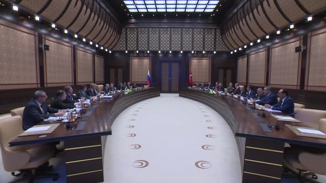 Turkish President Recep Tayyip Erdogan his Russian counterpart Vladimir Putin and their accompanying delegations hold a meeting at presidential...