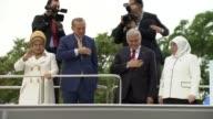 Turkish President Recep Tayyip Erdogan his wife Emine Erdogan and Turkish Prime Minister Binali Yildirim his wife Semiha Yildirim greet supporters...