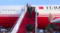 Turkish President Recep Tayyip Erdogan is welcomed by Minister For Investments And Development of Kazakhstan Zhenis Kassymbek and other officials...