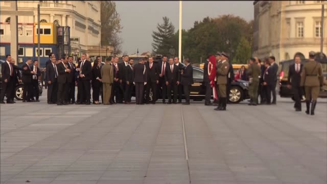 Turkish President Recep Tayyip Erdogan lays a Turkish flag wreath during his visit to the Tomb of the Unknown Soldier in Warsaw Poland on October 17...