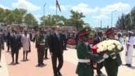 Turkish President Recep Tayyip Erdogan lays a wreath at Heroes Monument during his visit with President of Mozambique Filipe Nyusi in Maputo...