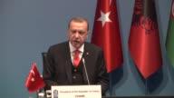 Turkish President Recep Tayyip Erdogan makes the opening speech during the 25th Anniversary Summit of the Organization of the Black Sea Economic...