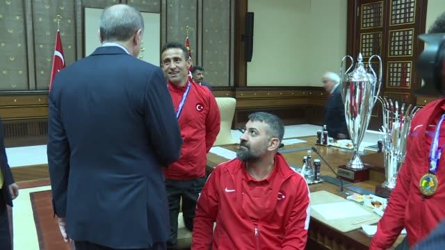Turkish President Recep Tayyip Erdogan receives players of Turkish Amputee National Football Team and Turkey Men's National Wheelchair Basketball...