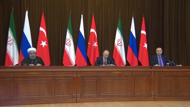 Turkish President Recep Tayyip Erdogan Russian President Vladimir Putin and Iranian President Hassan Rouhani hold a joint press conference following...