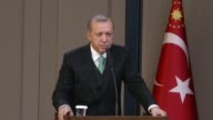 Turkish President Recep Tayyip Erdogan speaks during a press conference ahead of his departure to Belgium for NATO leaders' summit at Esenboga...