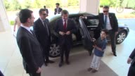 Turkish Prime Minister Ahmet Davutoglu and his wife Sare Davutoglu meets the children who will attend the 38th International April 23 Children's...