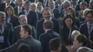 Turkish Prime Minister Ahmet Davutoglu and his wife Sare Davutoglu greet supporters as they arrive at Ankara Arena to attend the second extraordinary...