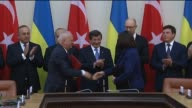 Turkish Prime Minister Ahmet Davutoglu and Ukrainian Prime Minister Arseniy Yatsenyuk attend a signing ceremony of bilateral agreements following...