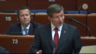 Turkish Prime Minister Ahmet Davutoglu answers question of Ertugrul Kurkcu representative of Turkey's Peoples' Democratic Party at the Parliamentary...