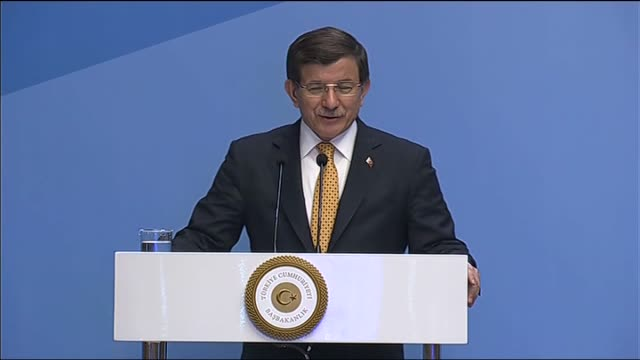 Turkish Prime Minister Ahmet Davutoglu delivers a speech during Turkey Greece Business forum at Swiss hotel in Izmir Turkey on March 08 2016