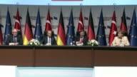 Turkish Prime Minister Ahmet Davutoglu European Council President Donald Tusk German Chancellor Angela Merkel and First VicePresident of EU...