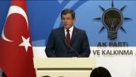 Turkish Prime Minister Ahmet Davutoglu holds a press conference after the executive board meeting of his Justice and Development Party at the AK...