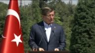 Turkish Prime Minister Ahmet Davutoglu hosts workers at a breakfast to mark May Day in the prime ministry office at Cankaya Palace in Ankara Turkey...