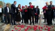 Turkish Prime Minister Ahmet Davutoglu leave carnations at scene of bomb blast outside main train station nearby Sihhiye Square in Ankara Turkey on...