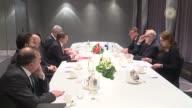 Turkish Prime Minister Ahmet Davutoglu meets with former Finnish President Martti Ahtisaari in Helsinki Finland on April 06 2016