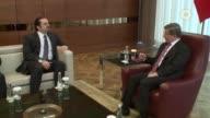 Turkish Prime Minister Ahmet Davutoglu meets with former Lebanese Prime Minister Saad Hariri at Ataturk Airport ��n Istanbul Turkey on April 30 2016