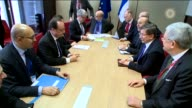 Turkish Prime Minister Ahmet Davutoglu meets with French President Francois Hollande on the sidelines of the European Union leaders summit in...