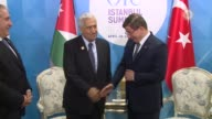 Turkish Prime Minister Ahmet Davutoglu meets with Jordanian Prime Minister Abdullah Ensour on the sidelines of the 13th Organization of Islamic...