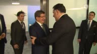 Turkish Prime Minister Ahmet Davutoglu meets with Libya's unity government Prime Minister Fayez Sarraj on the sidelines of the 13th Organization of...