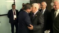 Turkish Prime Minister Ahmet Davutoglu meets with Palestinian President Mahmoud Abbas during the 13th Organization of Islamic Cooperation Summit at...