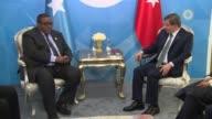 Turkish Prime Minister Ahmet Davutoglu meets with Somalian Prime Minister Omar Abdirashid Ali Sharmarke on the sidelines of the 13th Organization of...