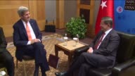 Turkish Prime Minister Ahmet Davutoglu meets with US Secretary of State John Kerry prior to NATO Foreign Ministers meeting in Antalya Turkey on May...