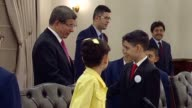 Turkish Prime Minister Ahmet Davutoglu receives children during a day marking 96th anniversary of the foundation of the Grand National Assembly and...