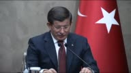 Turkish Prime Minister Ahmet Davutoglu speaks during a press conference at Esenboga International Airport ahead of his Turkish Republic of Northern...