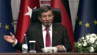 Turkish Prime Minister Ahmet Davutoglu speaks during at a joint press conference of TurkeyEU Aid Program for Syrian Refugees with German Chancellor...