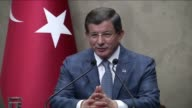 Turkish Prime Minister Ahmet Davutoglu speaks holds a press conference ahead of his Bosnia an Herzegovina visit at Esenboga International Airport in...