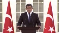Turkish Prime Minister Ahmet Davutoglu speaks on the attack in Istanbul's Sultanahmet tourist district during a meeting with the representatives of...