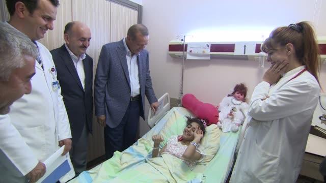 Turkish Prime Minister and Presidentelect Recep Tayyip Erdogan accompanied by Turkish Health Minister Mehmet Muezzinoglu visits injured Gazans at...